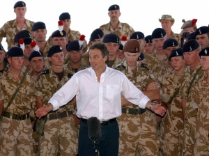 Basra, IRAQ: (FILES) -- File picture dated 29 May 2003 shows British Prime Minister Tony Blair addressing troops in Basra, Iraq.Blair announced 10 May 2007 his resignation after a decade in powerr, saying he will stand down at the end of June. He told party suporters in his constituency of Sedgefield that he would step down as Labour leader, and therefore as prime minister on June 27. AFP PHOTO POOL Stefan ROUSSEAU (Photo credit should read STEFAN ROUSSEAU/AFP/Getty Images)