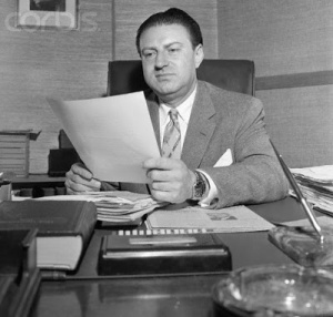 25 Apr 1956, Beverly Hills, California, USA --- Murray M. Chotiner, campaign manager for Vice-President Richard Nixon in the 1952 campaign, looks at a subpoena requesting his presence in Washington for questioning regarding his alleged legal services for a blacklisted government contractor. --- Image by © Bettmann/CORBIS